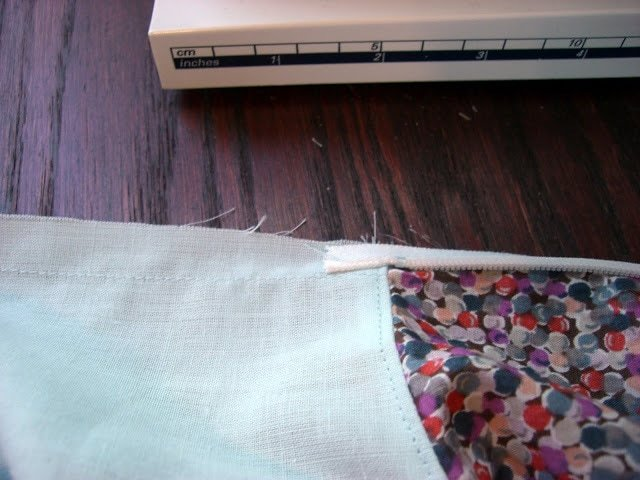 fold zipper and lining at the neckline