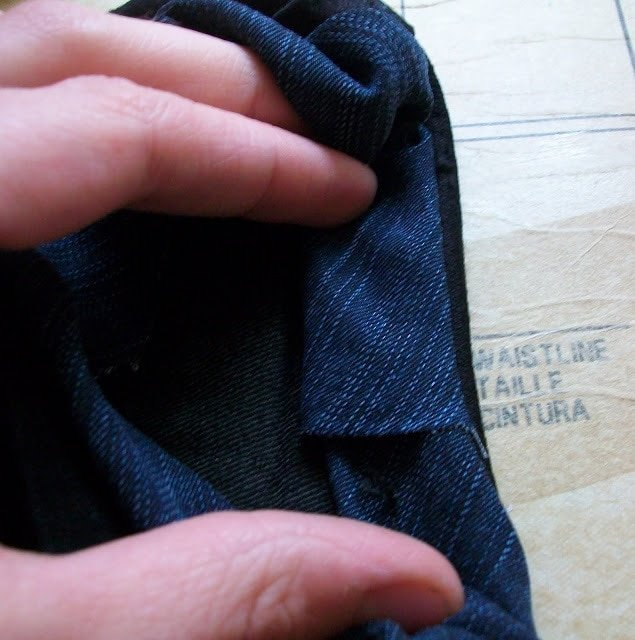 fold again tucking raw edge inside