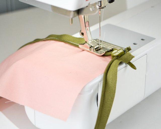 sew near zipper teeth with straight stitch