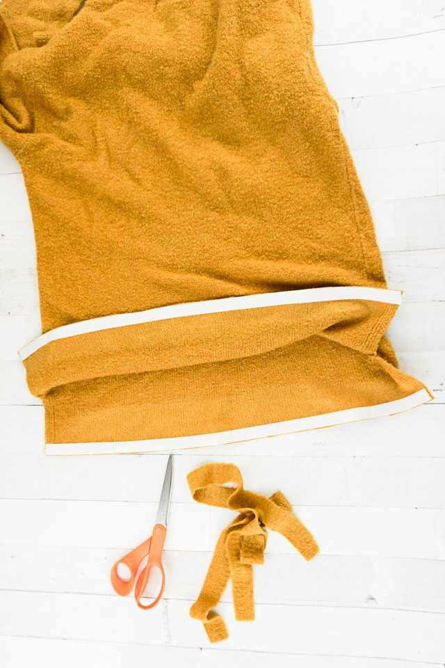cut excess sweater