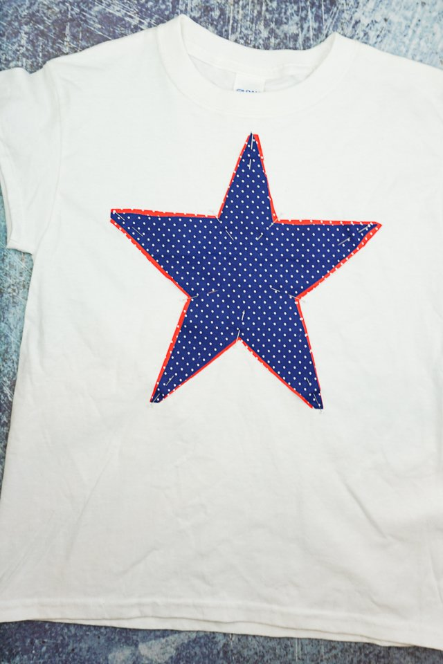 pin stars onto t-shirt