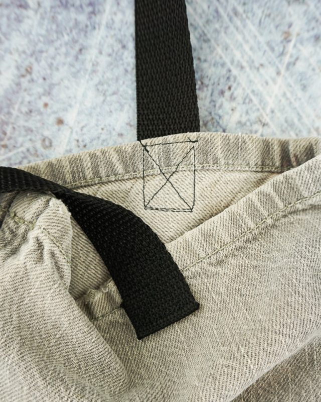 sew the edge of a strap in a square and x