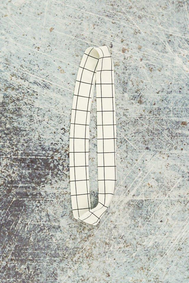 press neckband in half