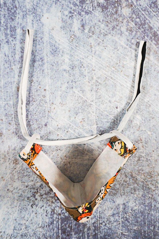 slide fabric through ear loops