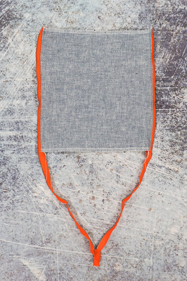 press and topstitch fabric away from zipper