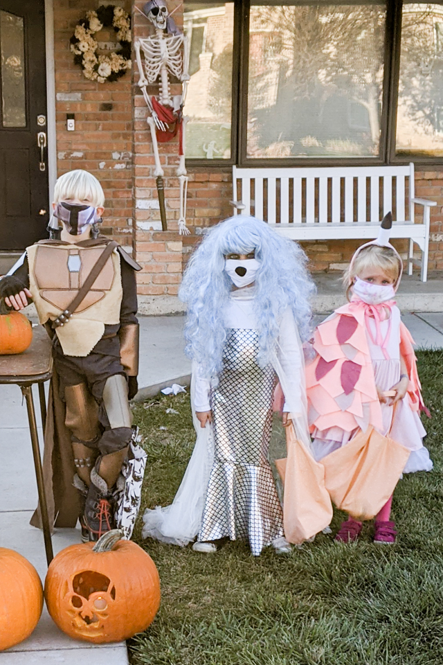 kids wearing masks halloween