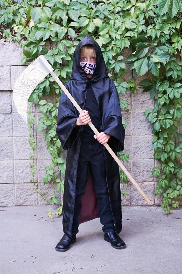 grim reaper wearing a mask