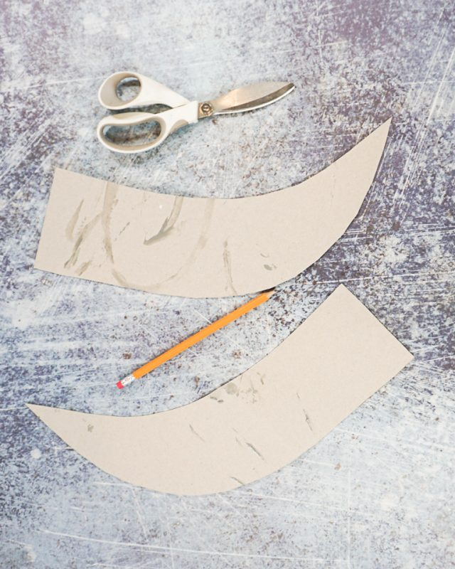 cut two pieces of curved cardboard