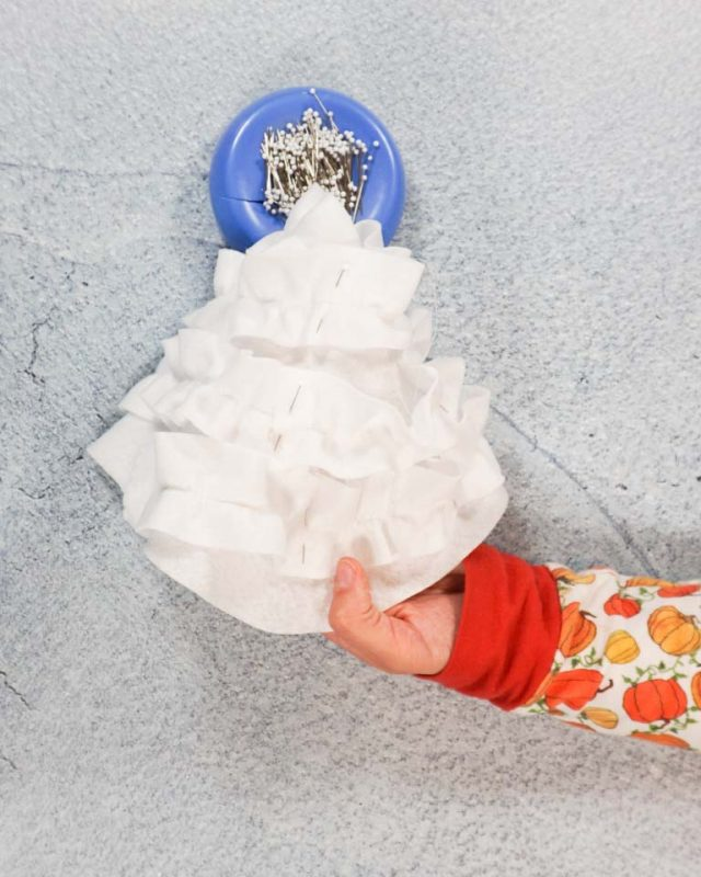 sew gathered strips to whipped cream cone