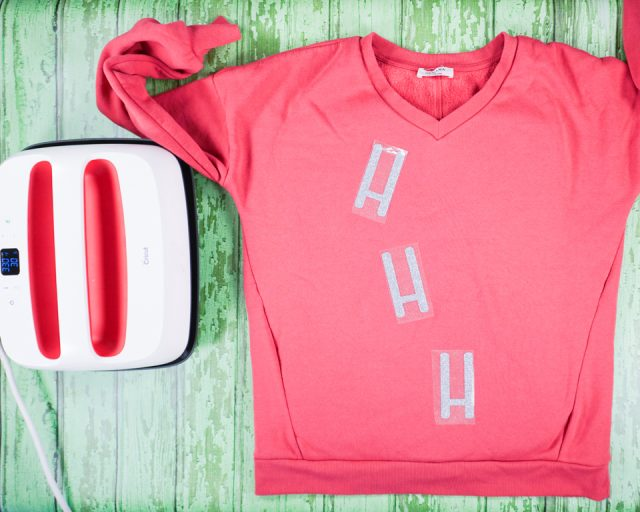 "place ""h's"" on the front of sweater"