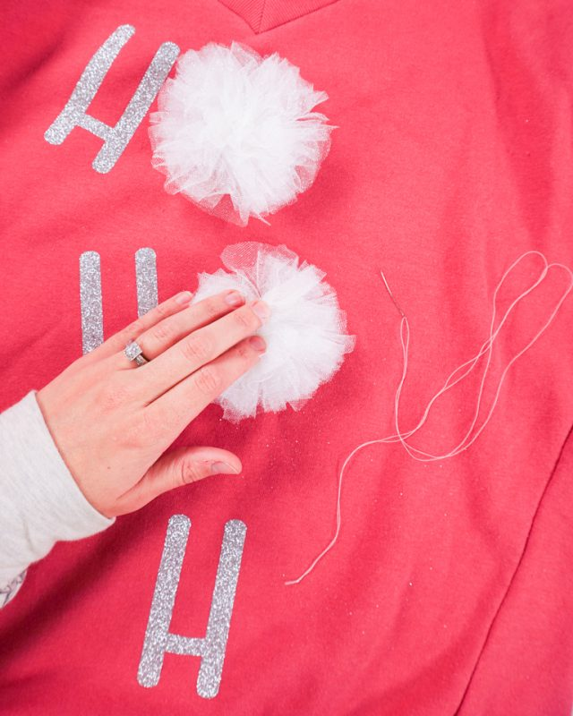 hand sew pompoms to sweater