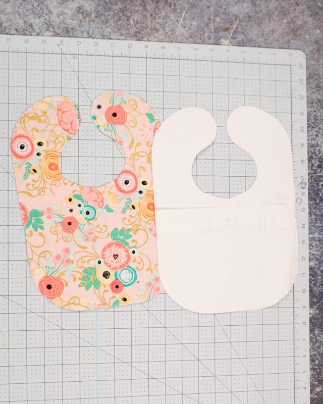 cut out two fabric bibs