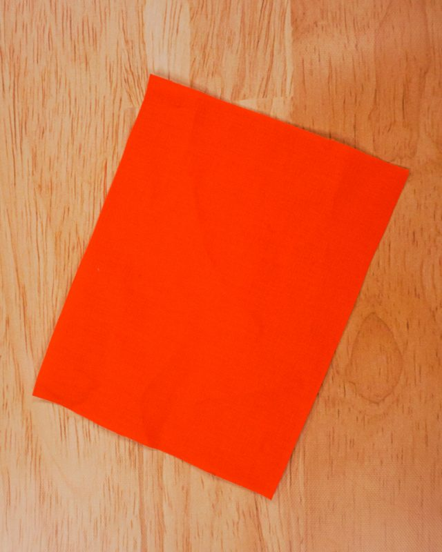 cut orange fabric rectangle