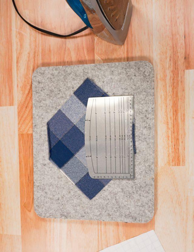 press a double fold hem on each short side
