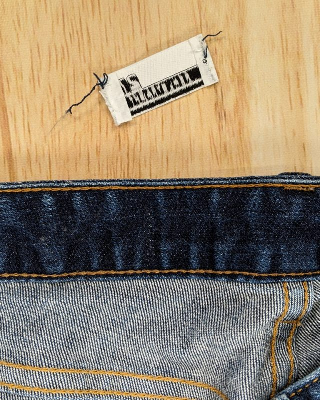 seam rip any tags that go through waistband