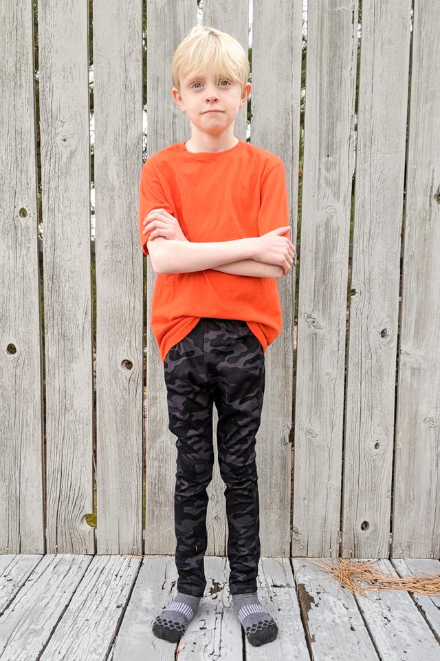 boy wearing t-shirt leggings