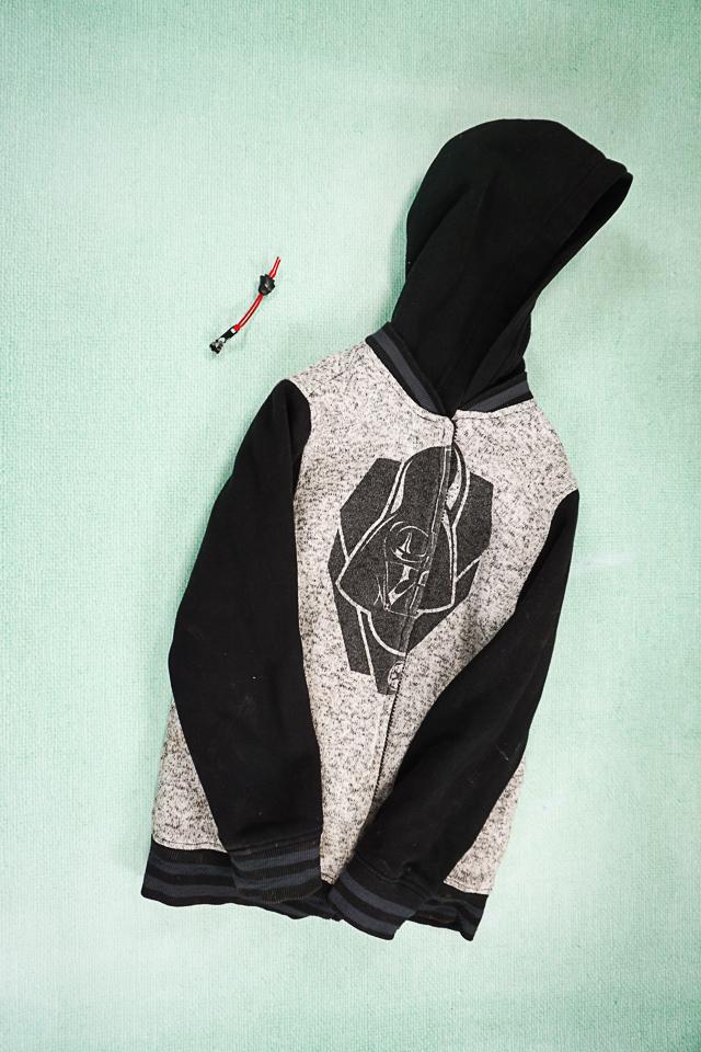 jacket with broken zipper pull