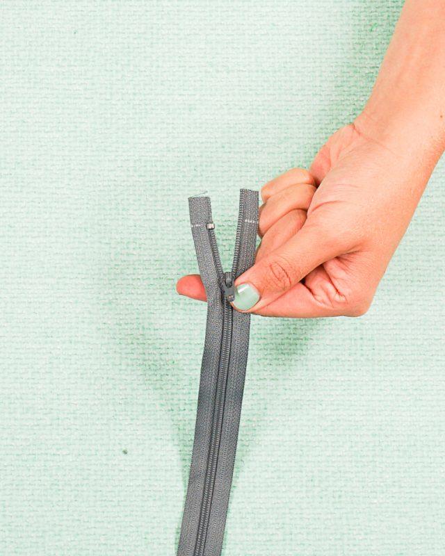 top zipper stop front