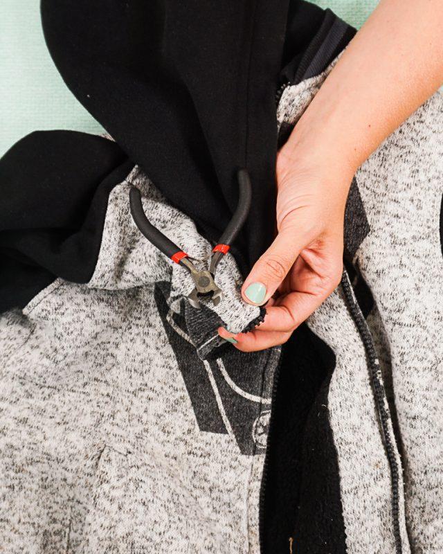 cut off the top right zipper stop