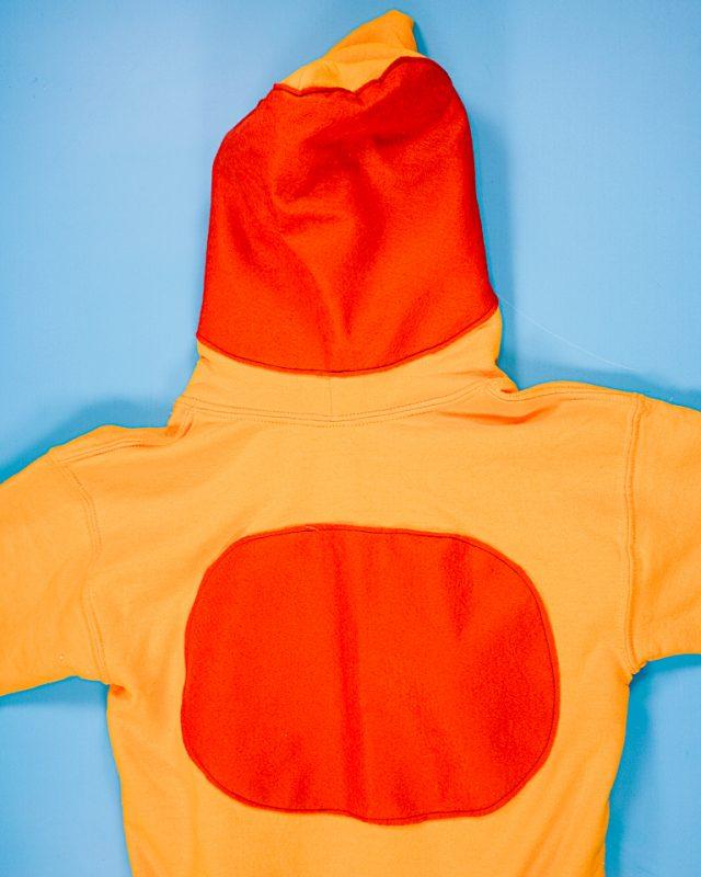 sew the spots onto the sweatshirt