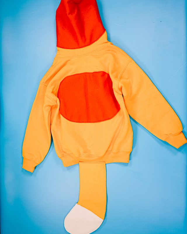 sew the tail onto the sweatshirt