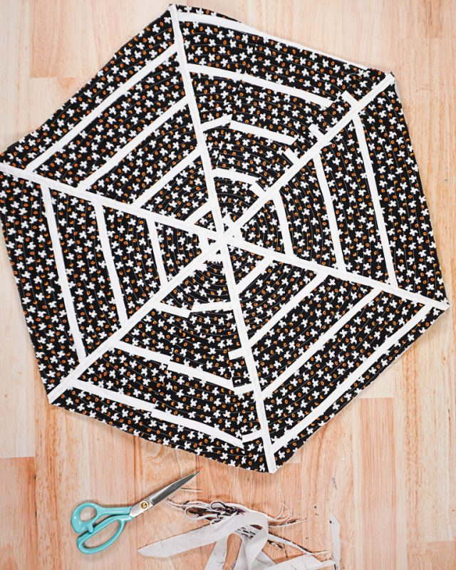 sew around the spiderweb to quilt the layers