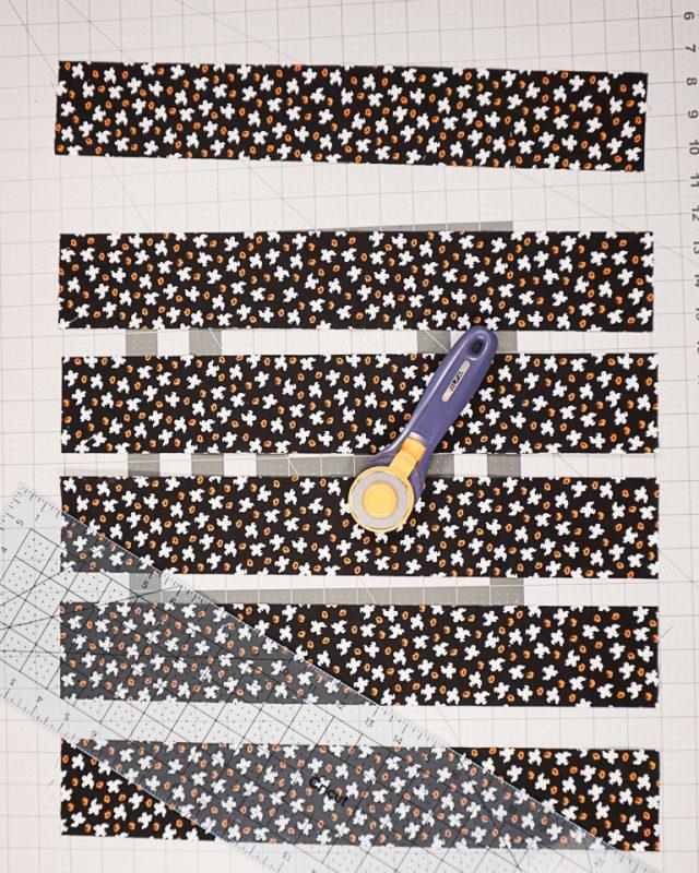 cut strips of black fabric