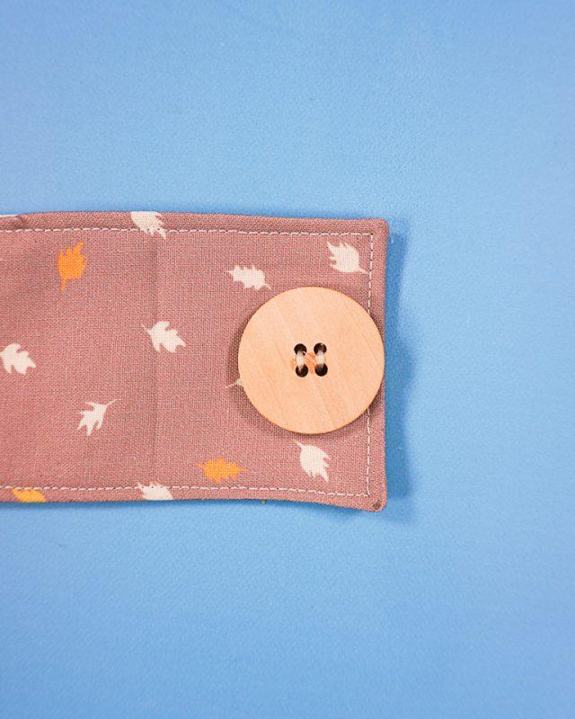 sew button onto mug cozy